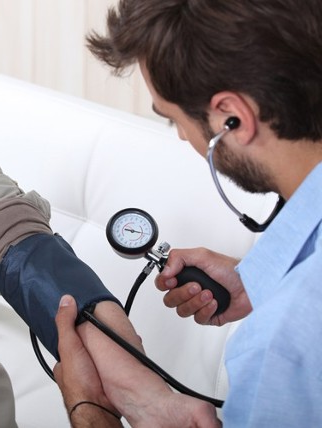 Doctor Checking Blood Pressure - Health Insurance